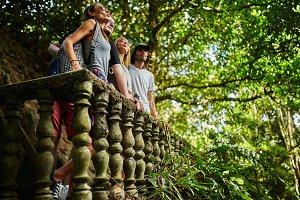tourists in thai jungle ruins