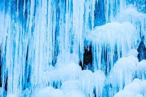 Frozen waterfall of blue ice