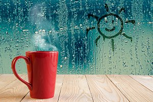 red coffee cup and sun sign