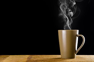 brown coffee cup with smoke