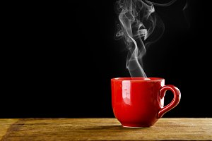 red coffee cup with smoke