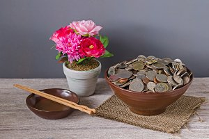 bowls filled with coins on table