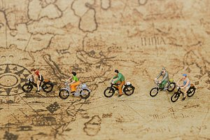 miniature people ride bicycle