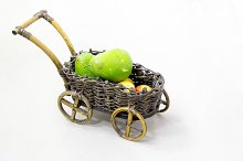 Wicker decorative cart with fruits