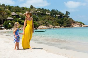 Beautiful mother, daughter at beach.