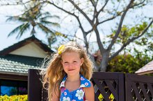Cute little lady in floral dress.