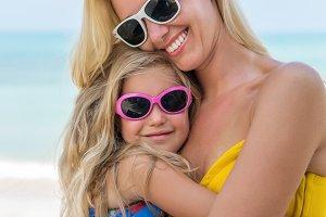 Beautiful mother, daughter at beach.