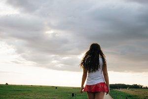 Woman walking on sunset