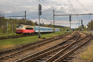 Passenger train goes fast on rails