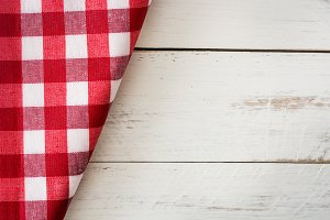 Checkered tablecloth and wood
