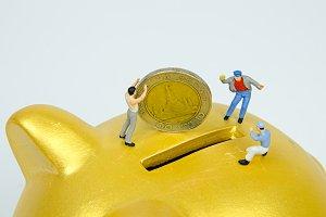 put a coin into pickky bank