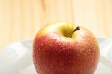 Apple on a white plate