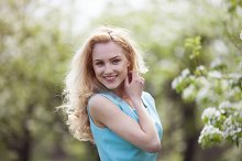 Beautiful young blonde woman in spring