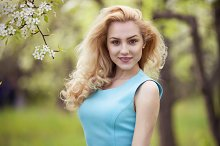 smiling girl natural beauty, lovely female walking spring nature, portrait of young lovely woman in spring flowers