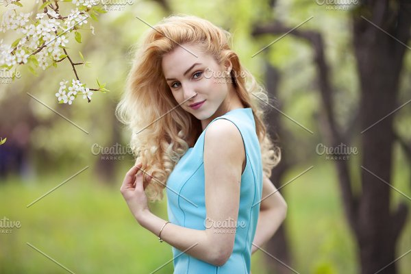 Smiling Girl Natural Beauty Lovely Female Walking Spring Nature Portrait Of Young Lovely Woman In Spring Flowers High Quality People Images Creative Market