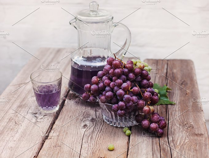 Fresh green and blue grapes.A carafe of grape juice - Food & Drink
