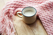 Still life details, cup of coffee and  knitted scarf