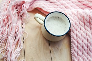 hot Cup of cappuccino and pink  woolen blanket. Cozy  house
