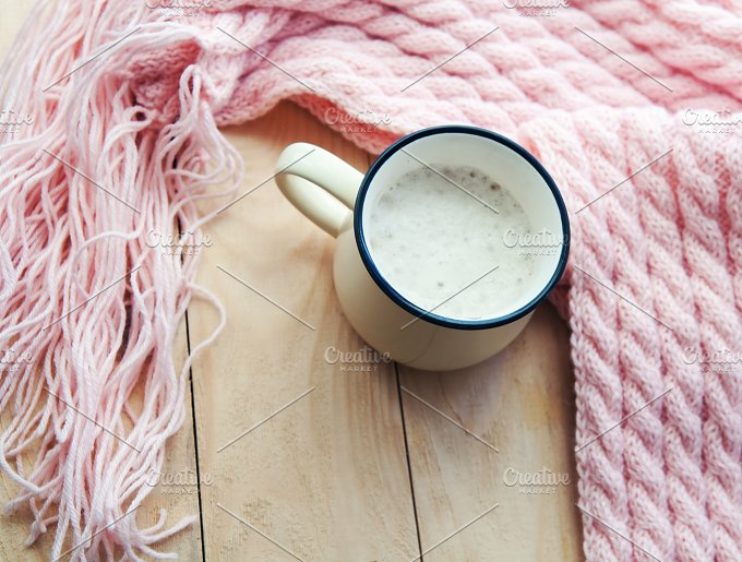 hot Cup of cappuccino and pink woolen blanket. Cozy house - Food & Drink