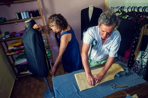 Couple working in tailoring