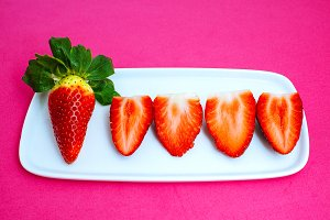Strawberries in pink background