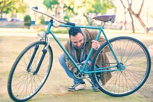 Man checking the chain an bicycle