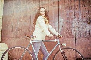 Woman with vintage bike