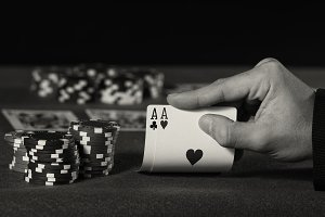 poker player with two aces