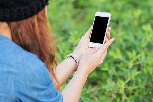 female holding smartphone.