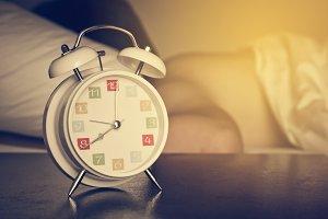 The white retro alarm clock.Vintage
