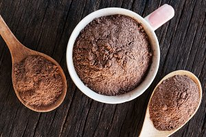 Cocoa powder on cup and  spoon