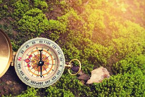 The retro compass, vintage photo.
