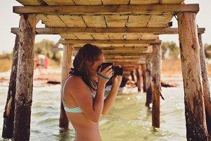 Happy Girl Photographed Under Pier