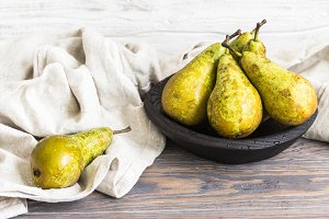 Juicy pears on a wooden plate