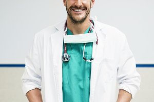 Handsome doctor working in hospital.