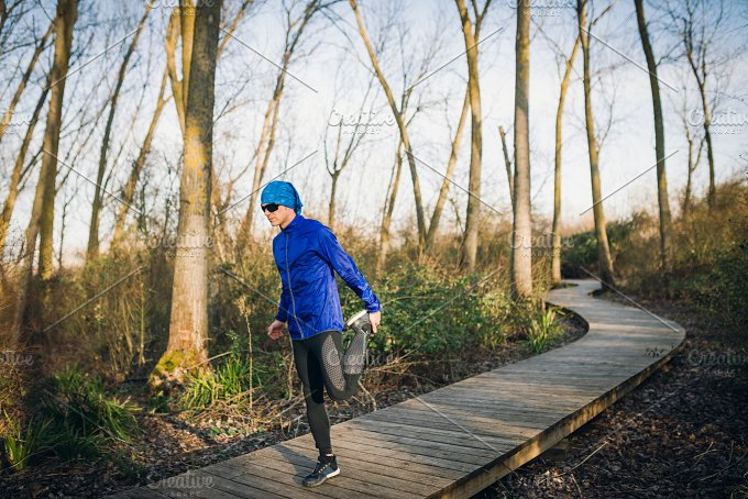 Man running in a promenade outdoors. Man is training - Sports