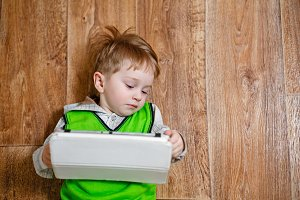 Little boy with a tablet pc
