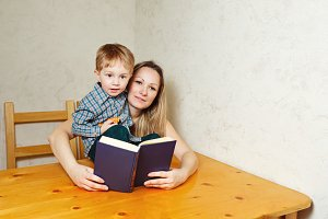 Mom and son reading a book