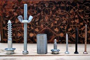 screws on elegant background