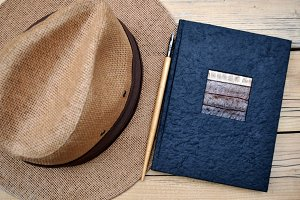 hat, notebook and antique pen