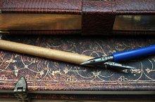 antique pens and books