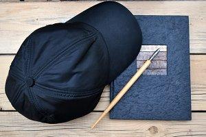 cap, notebook and antique pen