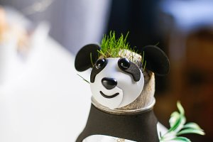 panda toy with grass
