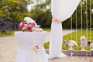 Beautiful wedding set up with pink pionies and orchids