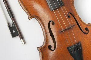 Old violin with a bow