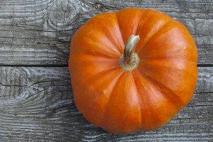 Ripe pumpkin on a wooden table