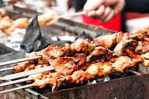 street food. skewers of meat on a skewer, fast food