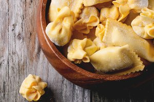 Pasta ravioli in wooden bowl