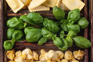 Box of pasta ravioli and basil