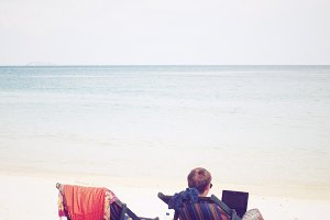 Enjoy using laptop on beach